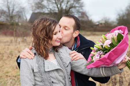 Lovers Kissing With Bouquet