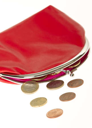 Handbag with few euro change left isolated on white background