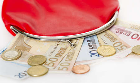 Red purse with euro paper money and change isolated on white background Stock Photo