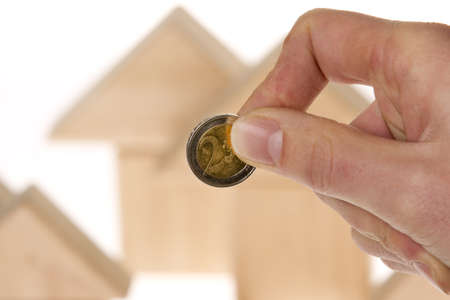 Man investing euro currency for house plan