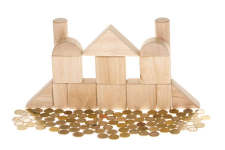 A wooden structure surrounded with coins isolated on white background