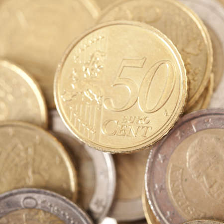 Closeup of fifty gold euro currency with other cents