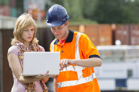 Businesswoman and worker with laptop Stock Photo - 15447663