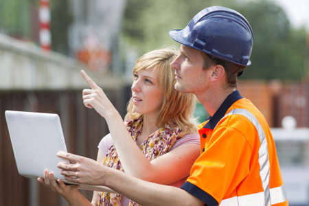 Businesswoman and worker with laptop photo