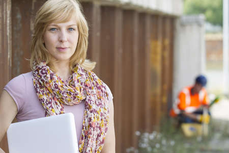 Casual businesswoman with laptop Stock Photo - 15447664