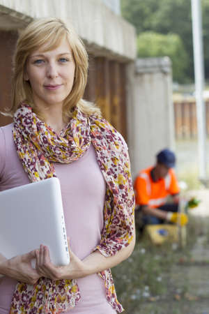 Casual businesswoman carrying laptop Stock Photo - 15447668