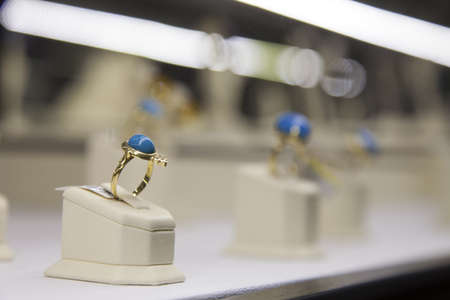 Ring with blue gem on display in a jewelry store  Horizontal shot  Stock Photo