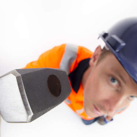 Man holding hammer Stock Photo