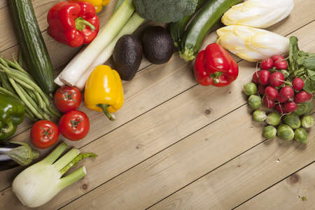 Variety of vegetables on wooden surface Standard-Bild