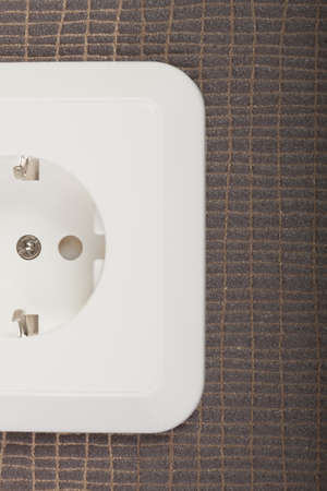 Cropped image of outlet on textured background