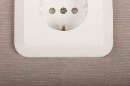 Cropped image of white outlet on textured background