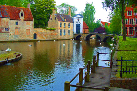 The canal and Begijnhof in Bruges Stock Photo