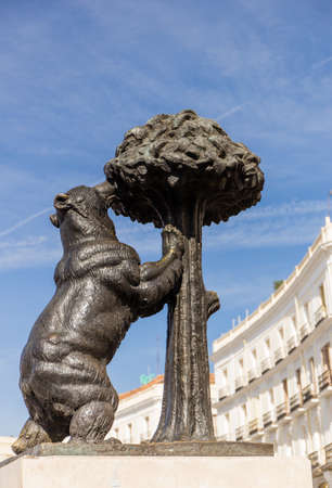 The statue of El Oso or the Bear and the Strawberry Tree (by sculptor Antonio Navarro Santa Fe) at Puerta del Sol in Madrid, Spain.