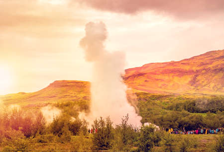 breakout: Strokkur geyser at Geyser at Iceland at sunset Stock Photo