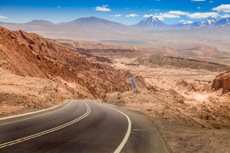 Road leading through the arid landscape at the Valley of the Moon in Chile Stok Fotoğraf