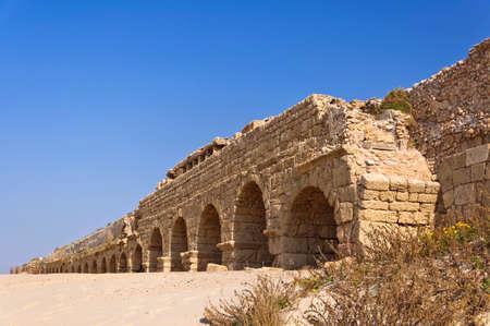 Ruins of ancient aquaeduct in Cesarea (Israel)