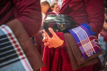 Monk hands holding bowl in the Mahagandayon monastery