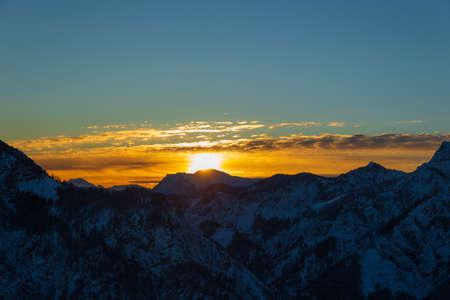 Colorful sunrise on top of austrian mountain alps