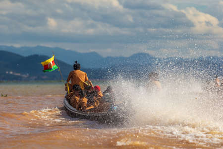Speed boat running on Inle (Inlay) lake in Myanmar