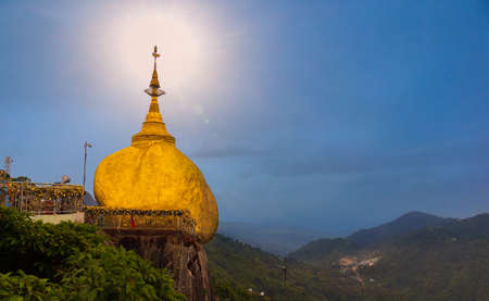 The famous Golden Rock in Myanmar before sunset Imagens