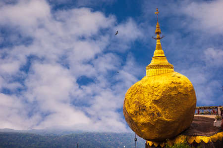 The famous Golden Rock in Myanmar with blue sky