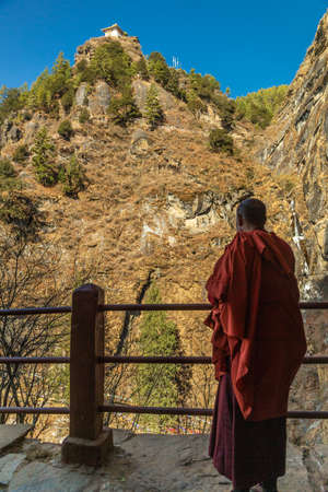 Monk looking out from the Tigers Nest Monastery, Bhutan