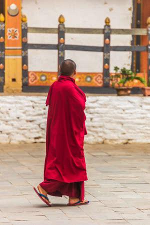 A walking Monk in Bhutan Stockfoto - 131829952