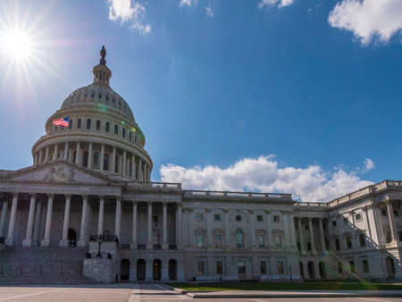 Wide angle shot of the United States Capitol Building on a sunny day