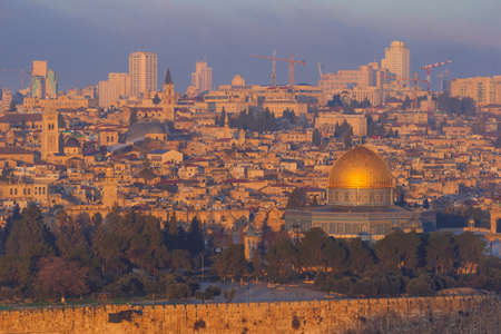 Jerusalem old town skyline with the dome of the rock in the center at dawn