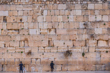 Huge Western Wall with small humans praying - Jerusalem, Israel