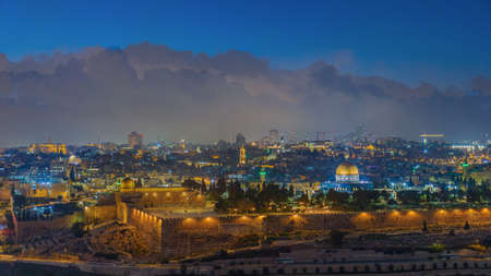 Jerusalem old town skyline with the dome of the rock in the center, evening hour