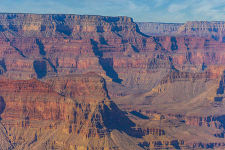 The landscape of the Grand Canyon with some clouds in the sky