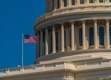 The US Capitol and US flag close up Foto de archivo