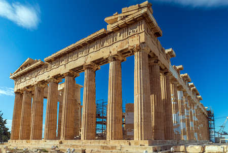 Parthenon temple with blue sky and some clouds