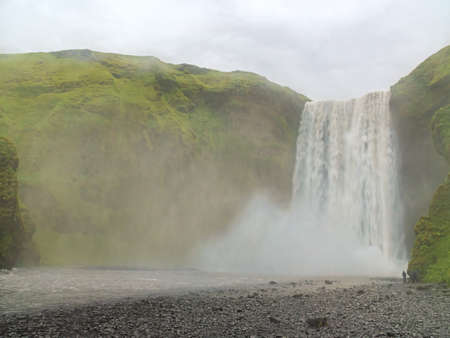 The Skogafoss waterfall in the south of Iceland at the cliffs of the former coastline Archivio Fotografico