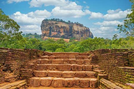 Lion rock in Sigiriya, under wonderful sky with beautiful clouds
