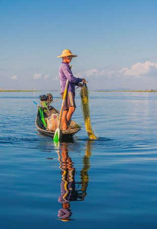 Inle Lake, Myanmar - January 4, 2018: Young Burmese Man Preparing His Fishing Net