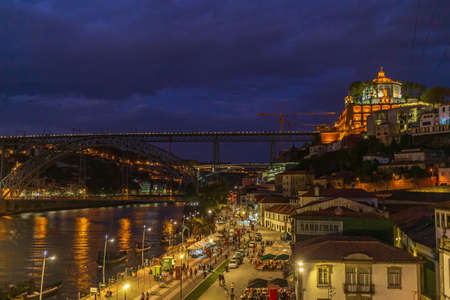 Panoramic view of the city of Porto including the Ponte Dom Luis at night - Portugal.