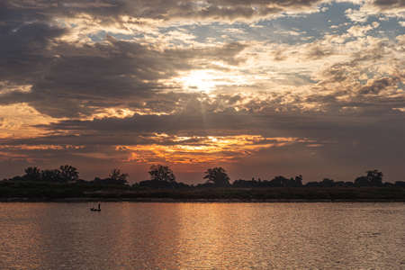 Sunset on the Irrawaddy river in Myanmar Archivio Fotografico