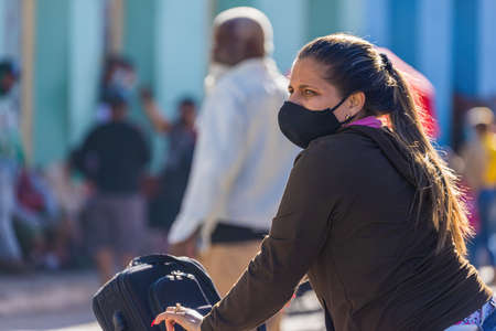 Woman wearing a nasobuco to protect herself from the in Cuba. Editorial
