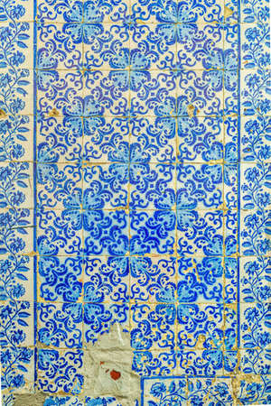 Traditional tiles (azulejos) from facade of old house in Lisbon, Portugal