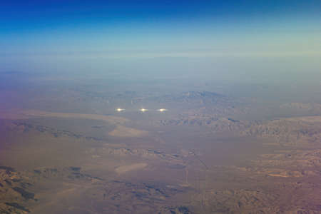 Solar heliostat concentrating the suns rays to produce electricity in the Mojave Desert