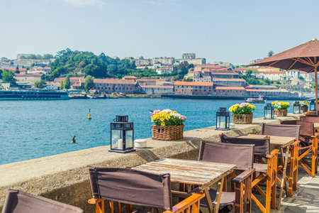 Cafe on the banks of the River Douro with a beautiful view in Porto, Portugal