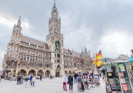 MUNICH, GERMANY - APRIL 03, 2021: People in downtown Munich, Marienplatz, walk on the square in mask due to Coronavirus virus. Editorial