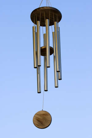 chimes: Wind Chimes blowing in the summer air.