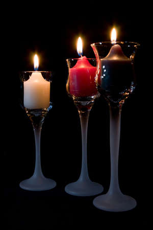candle: Three (3) Candles burning in decorative candle holders. Stock Photo