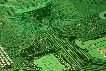 Close up of a Green computer circuit board. photo