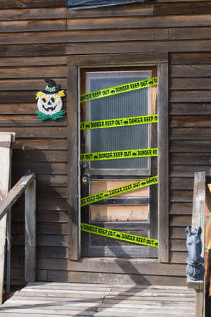 keepout: Keep-Out and Danger Tape on a Haunted House door.