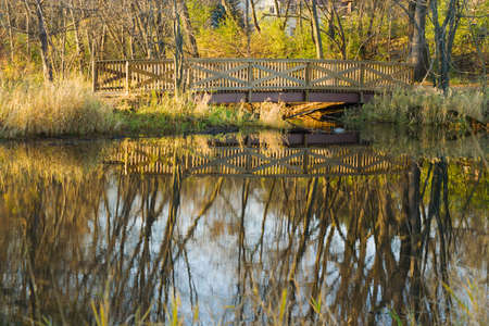 Walkway bridge over the pond at the park. Stock Photo - 5998787