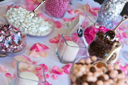 a marriage meeting: Colorful Wedding Candy Table with all the chocolate goodies on display. Stock Photo